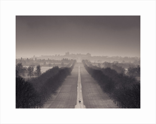 England, Berkshire, Aerial view of two people walking on long path with windsor castle in background by Assaf Frank