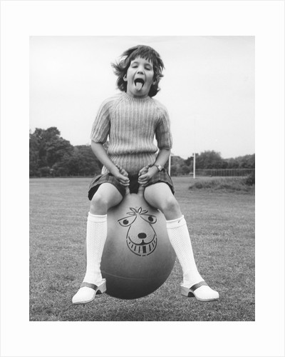 Girl on a space hopper, 1970s by Tony Boxall