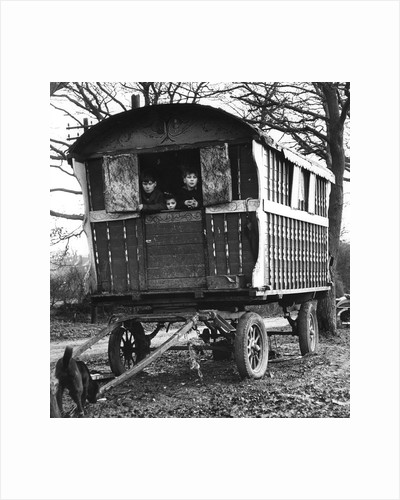 Gipsy children looking out of their caravan by the roadside, Charlwood, Surrey, 1964 by Tony Boxall