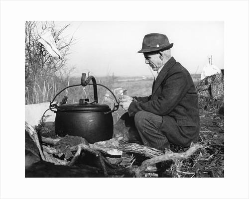 Gypsy man with cauldron, 1960s by Tony Boxall