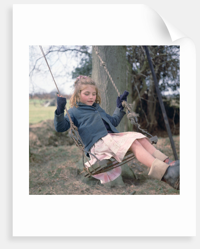 Young gipsy girl on a swing, Charlwood, Newdigate area, Surrey, 1964 by Tony Boxall