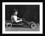 Boy driving a home-made go-kart, Horley, Surrey, 1965 by Tony Boxall