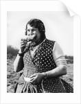 Gypsy woman eating, 1960s by Tony Boxall