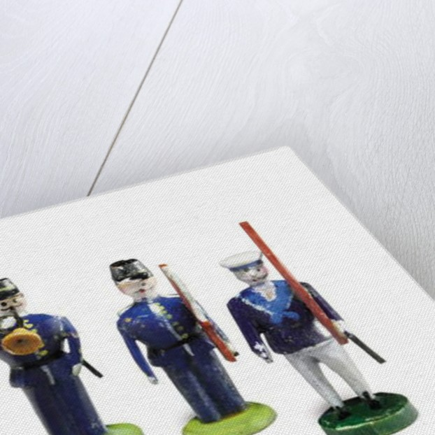 A group of five hand-carved and hand-painted toy soldiers owned by Tad Lincoln by American School