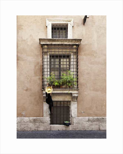Rome: Woman climbing wall to water plant by Pat swain