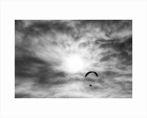 Paraglider against a cloudy sky, 2016 by Joseph S Giacalone