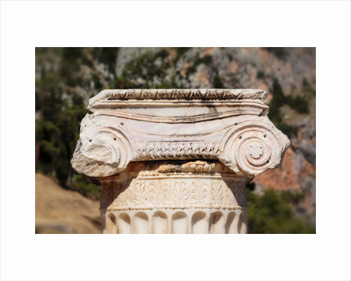 Ancient Delphi, Phocis, Greece. Broken column on the Sacred Way crowned by Corinthian capital by Anonymous