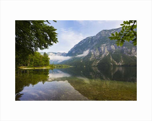 Canoes for rent. The church of St. John at Ribcev Laz in background, Lake Bohinj by Anonymous