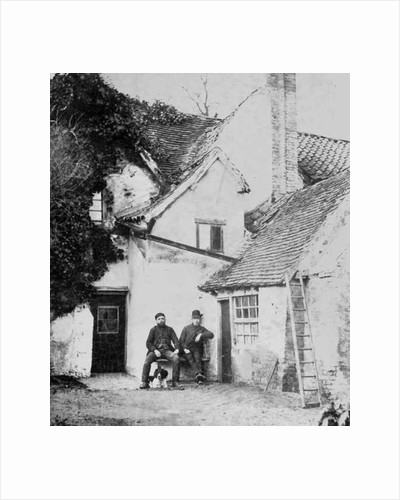 Two men outside Enfield cottage by English Photographer