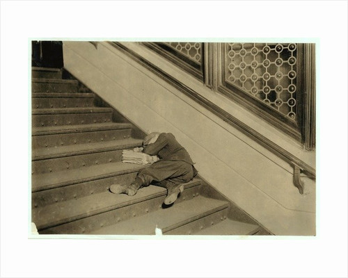 Newsboy asleep with his papers in Jersey City, New Jersey by Lewis Wickes Hine