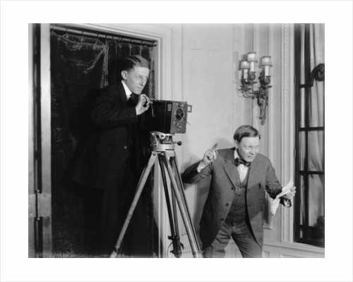 Two men using a movie camera indoors by Detroit Publishing Co.