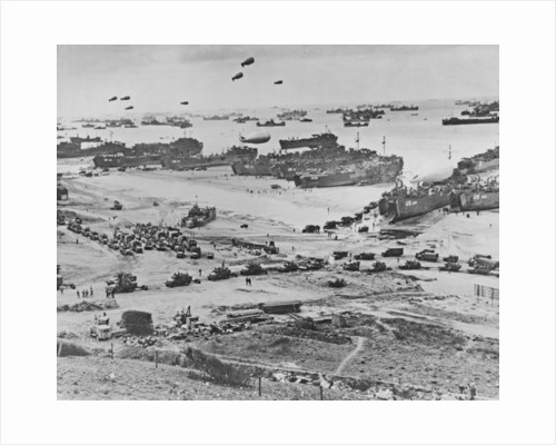 Bird's-eye view of landing craft, barrage balloons, and allied troops landing in Normandy, France on D-Day by American Photographer
