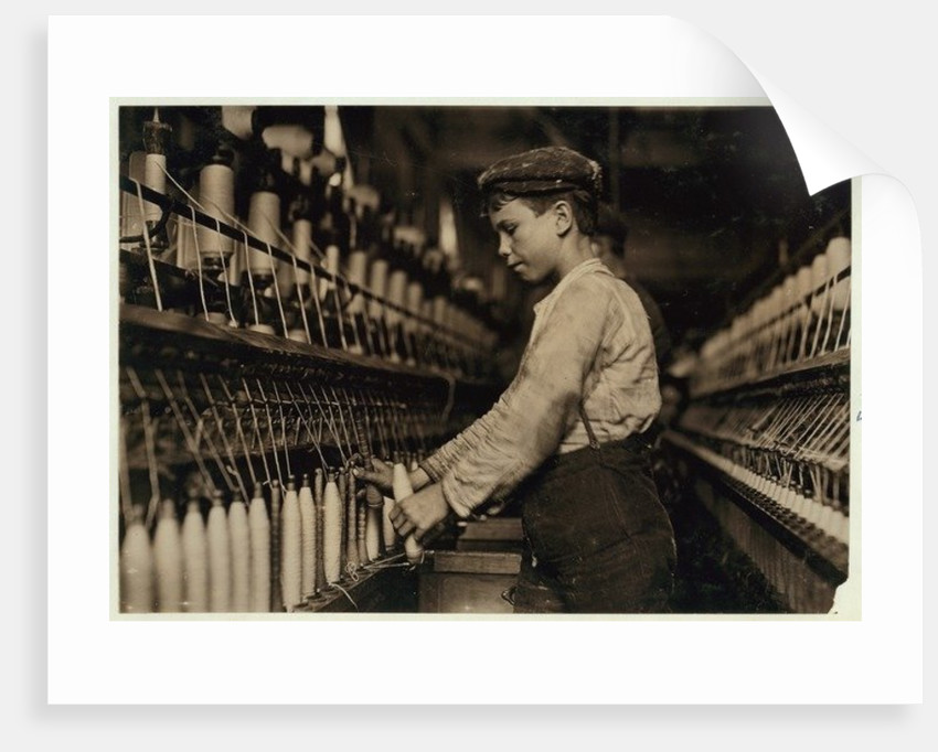 A doffer replaces full bobbins at Globe Cotton Mill, Augusta, Georgia by Lewis Wickes Hine