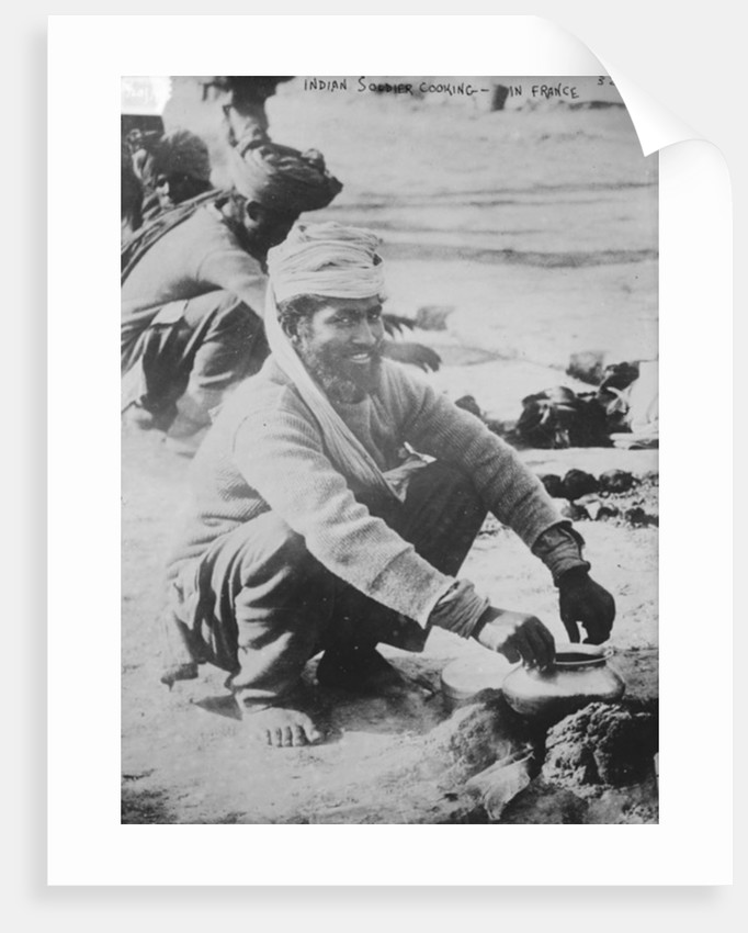 Indian soldier cooking in France by French Photographer