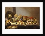 Bowls of Fruit and Nuts on a wooden table with a Basket of Pears beneath by Floris van Schooten