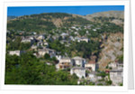 Gjirokastra or Gjirokaster: Looking across the typical architecture of the old town to new suburbs beyond by Anonymous