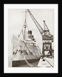 The RMS Mauretania docked and beingpainted by Anonymous