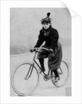 Woman on a bicycle by French Photographer