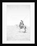 Bedouin warrior making his camel kneel by Anonymous