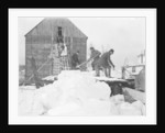 Ice harvesting, shooting the cakes into the house by Detroit Publishing Co.