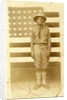 World War I soldier with American flag in background by American Photographer
