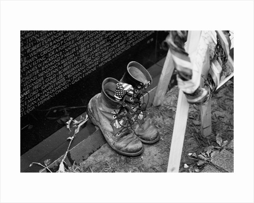 Combat boots at the Vietnam Veterans Memorial by Michael Katakis
