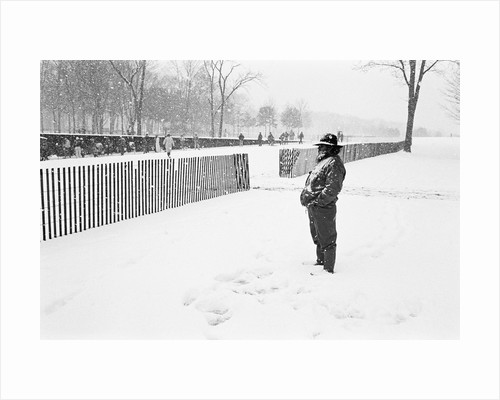 Veteran in the snow at the Vietnam Veterans Memorial by Michael Katakis