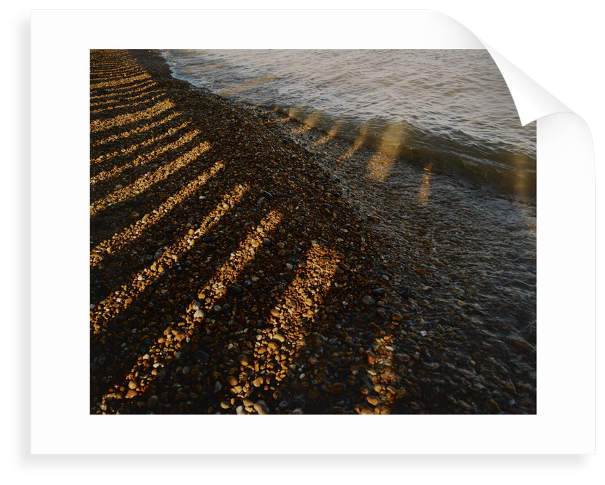 Wave breaking on shingle shore by Fay Godwin