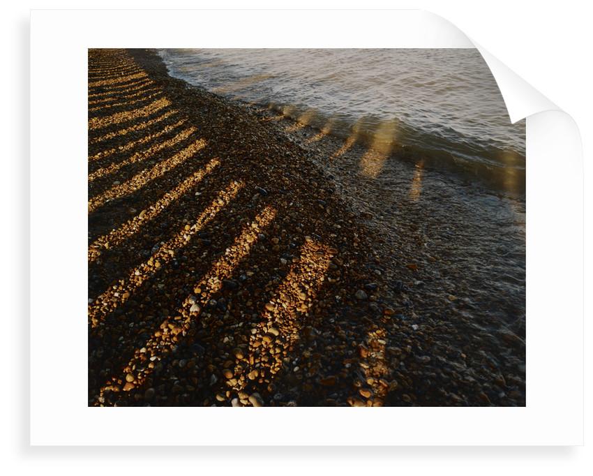 Wave breaking on shingle shore by Fay Godwin