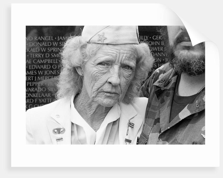 Evelyn Barbour visiting the Vietnam Veterans Memorial by Michael Katakis