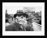 Masked veteran protesting by Michael Katakis