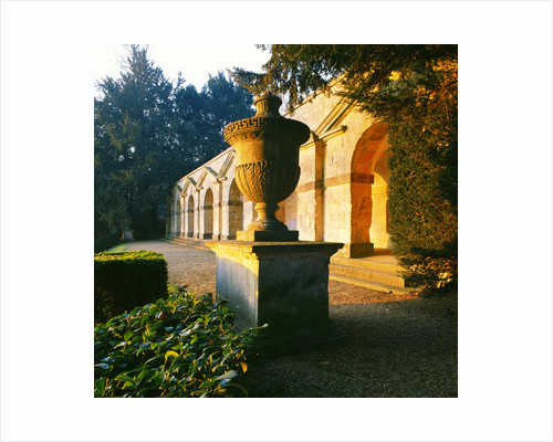 Golden Light Of Dawn: Classic Stone Urn In F/g And Behind It The Arcade Viewpoint Known As Praeneste At Rousham, Oxfordshire by Clive Nichols