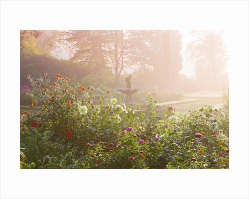 Ragley Hall Garden, Warwickshire: Fountain Garden At Dawn With Dahlias. Mist by Clive Nichols