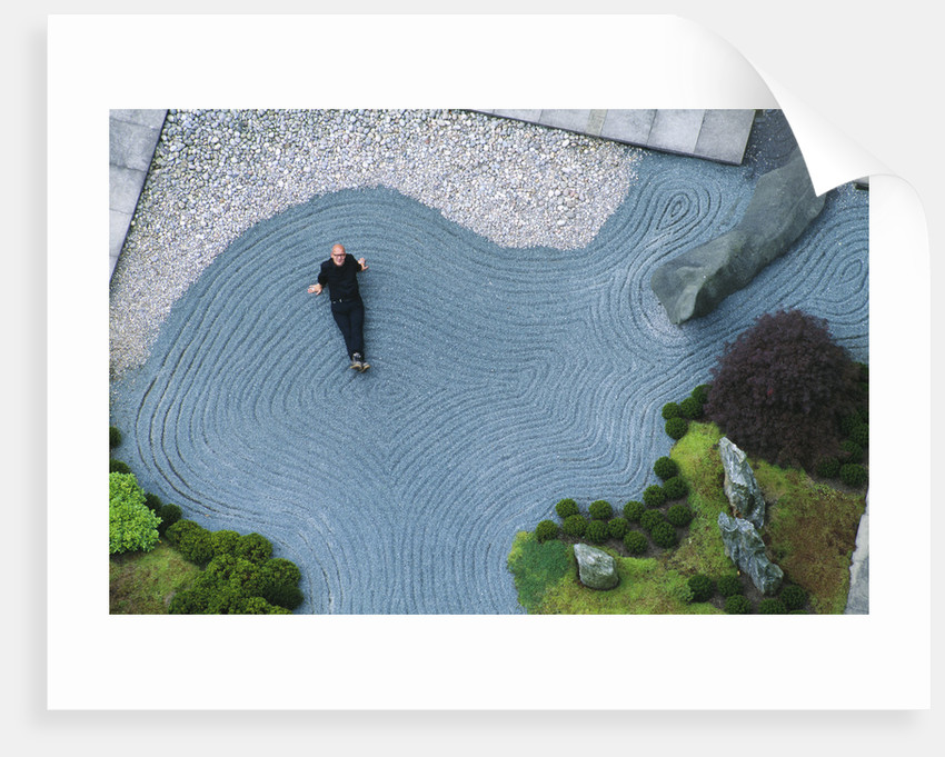 Tony Heywood Lies In Raked Gravel In The Swimmer, A Japanese Inspired Landscape By Tony Heywood Of Conceptual Gardens At The Water Gardens, London by Clive Nichols