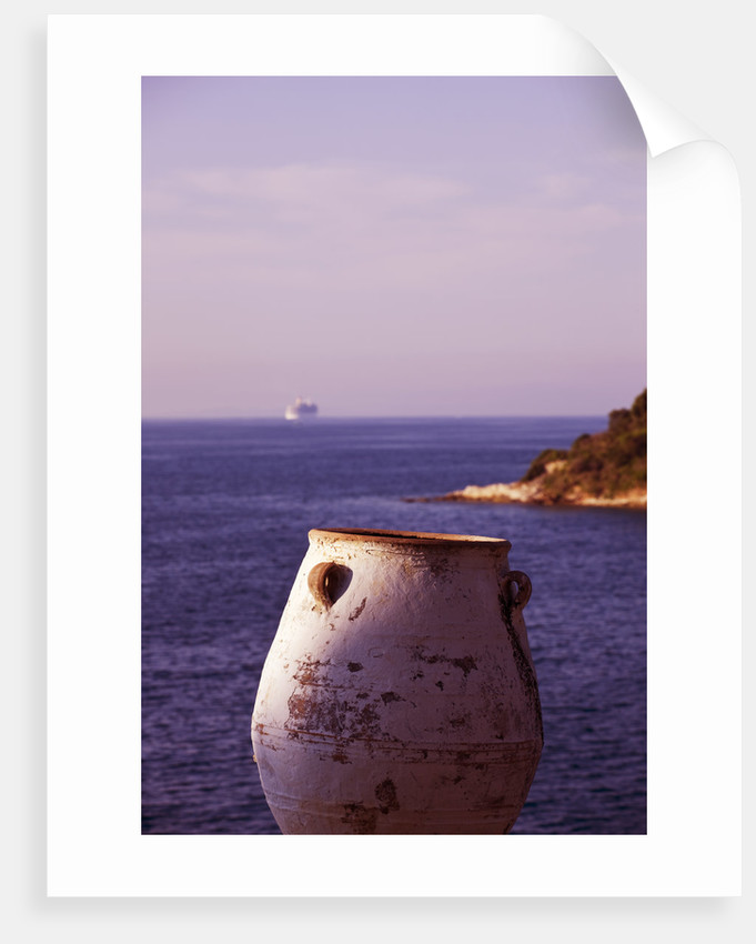 Corfu, Greece: Designer: Dominic Skinner - Meditteranean Style Garden  - View To White Terracotta Container Beside Swimming Pool With Sea And Ferry Boat Beyond by Clive Nichols