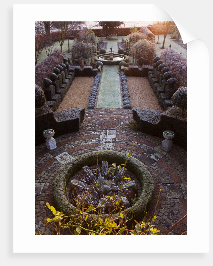 The Manor House, Stevington, Bedfordshire. Designer: Kathy Brown - The French Parterres At Dawn - View Along The Formal Garden With Clipped Yew Hedges by Clive Nichols