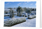 Snow Covers The Lower Parterre With Box And Yew Shapes And The Countryside Beyond. Pettifers Garden, Oxfordshire by Clive Nichols