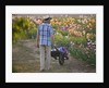 Iris Cayeux, France - Man With Cart In Iris Show Fields by Clive Nichols