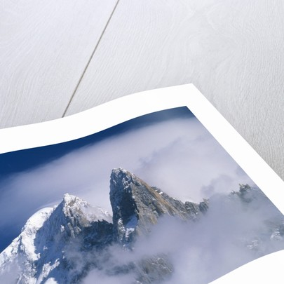 France, Alps, Mont Blanc Massif, Aiguille Verte, peak in clouds by Corbis