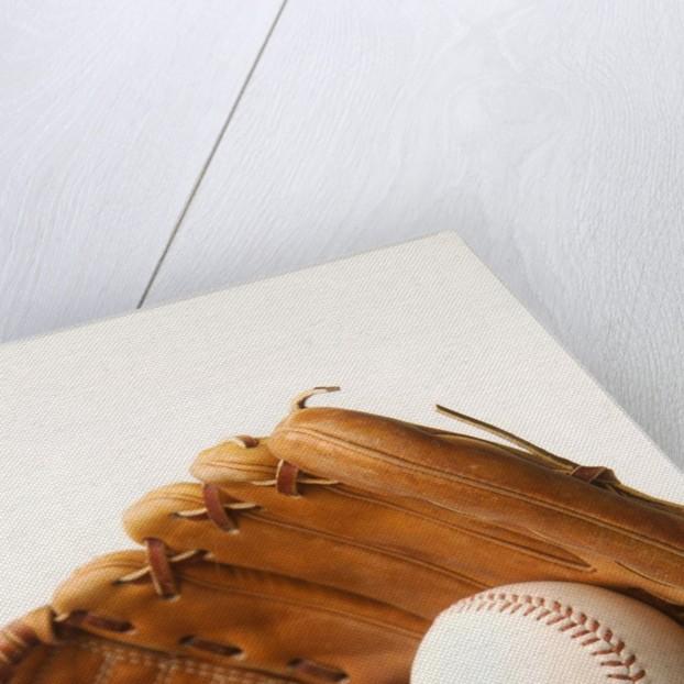 Baseball glove and ball by Corbis