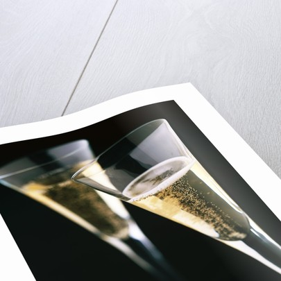 Two glasses of champagne by Corbis