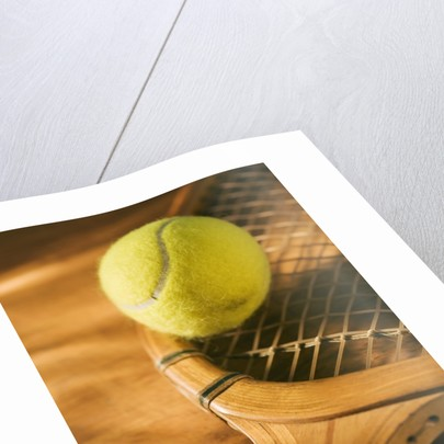 Tennis Ball and Wood Racket by Corbis