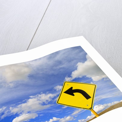 Curve Road Sign on Highway Against Sky by Corbis