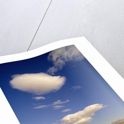 Clouds in Sky Above Rural Freeway by Corbis