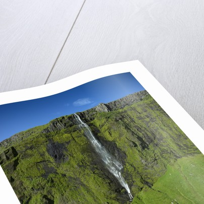 Drifandi Waterfall and Moss-Covered Cliff by Corbis