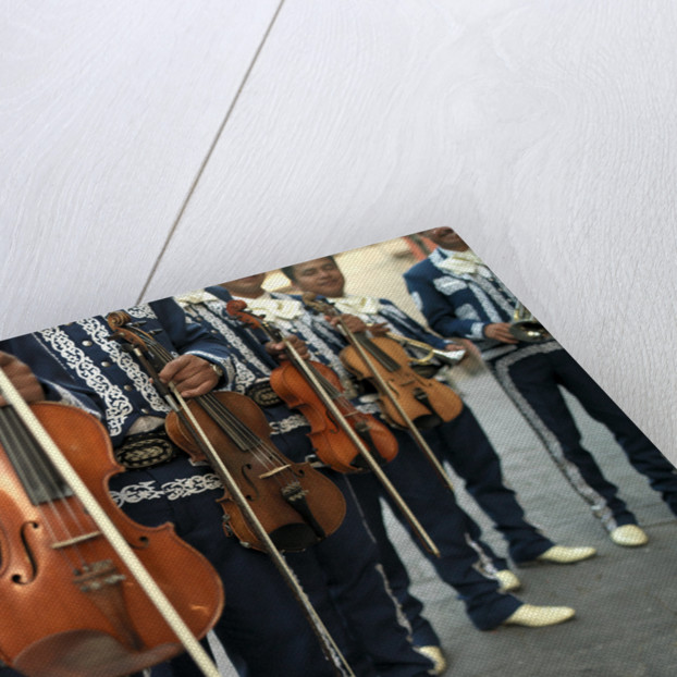 Mariachi Violin Players Line Up by Corbis