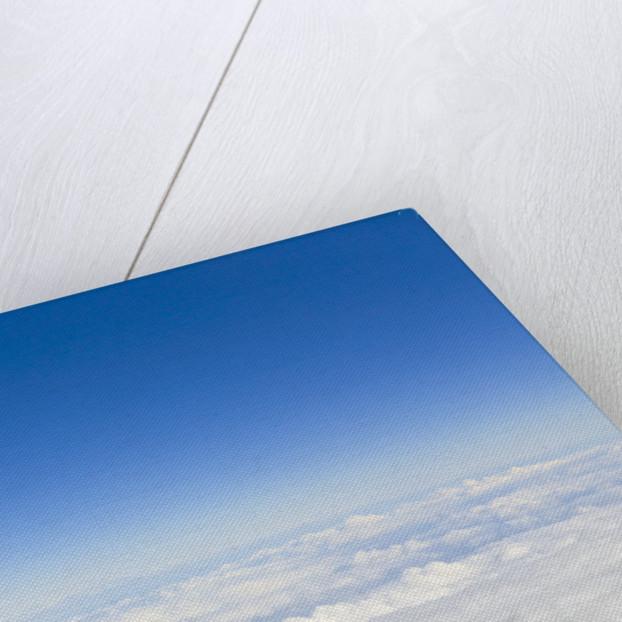 Thick Cumulus Clouds Below Clear Sky by Corbis