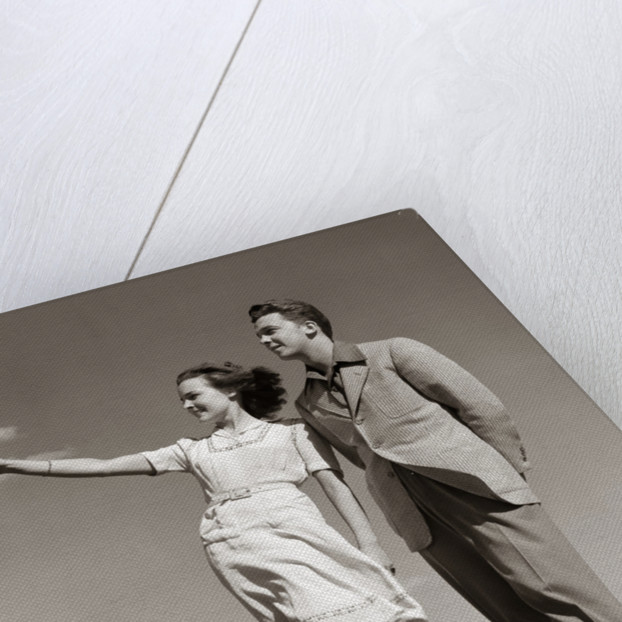 1940s Teenage Couple Standing Together Outdoors Girl Pointing by Corbis