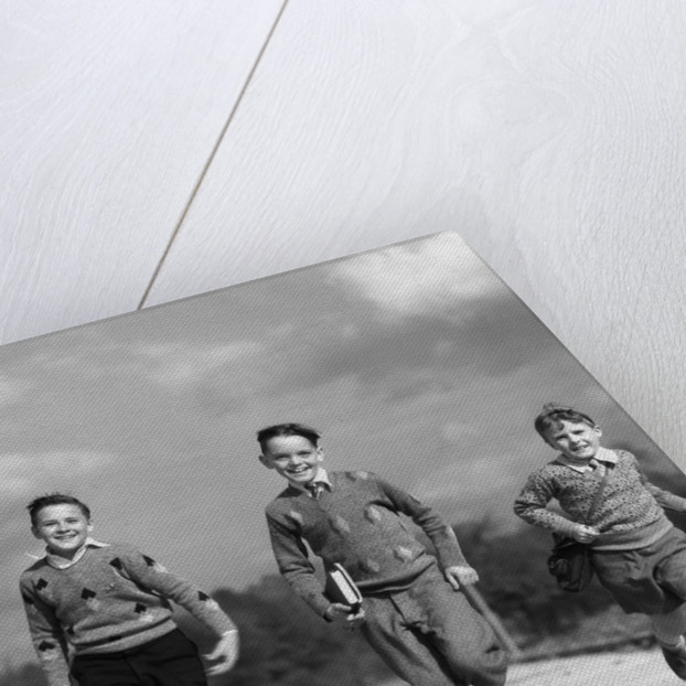 1930s Three Boys Running School Books by Corbis