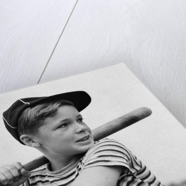 1930s Boy At Bat Wearing A Horizonal Striped Tee Shirt and Baseball Cap by Corbis